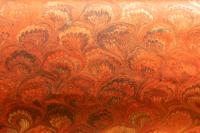 Carta marmorizzata arancione pavonato